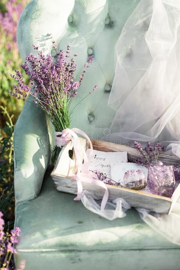 Chair decoration in purpur lavender field on golden sunset stock photography