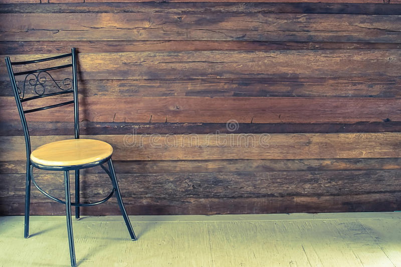 Chair in an empty room. With wooden floor and backgroundvintage stock images