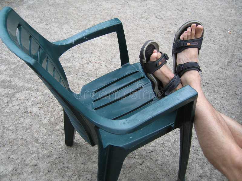 Download Chair With Feet On It Royalty Free Stock Images - Image: 392159