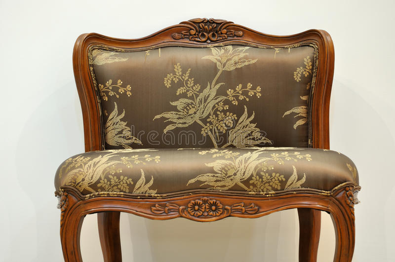 Chair with flowery style. A flowery and comfortable chair individual, shown as featured furniture or vacant position royalty free stock photography
