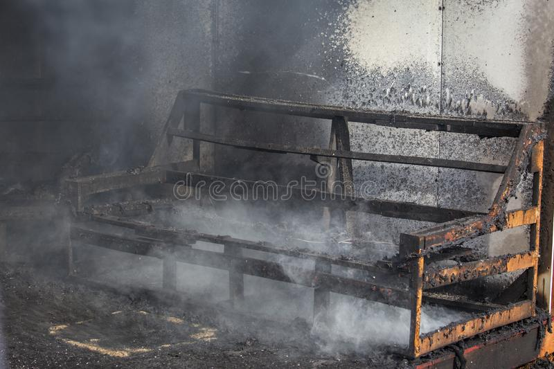 Chair and furniture in room after burned in burn scene of arson royalty free stock photo