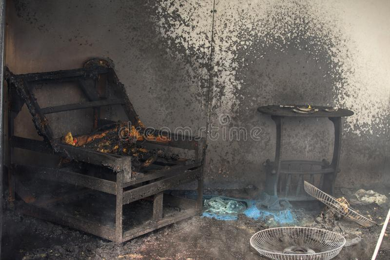 Chair and furniture in room after burned in burn scene of arson stock photo