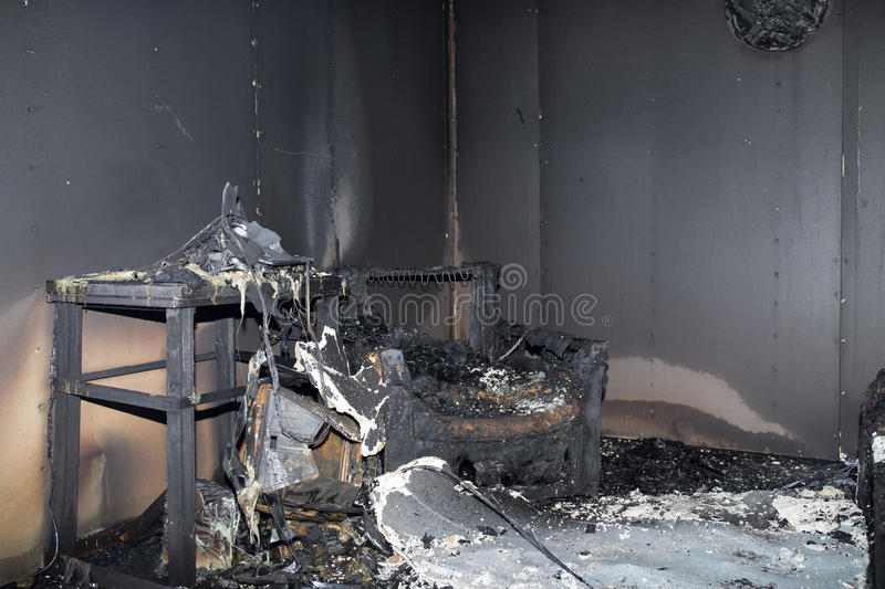Chair and furniture in room after burned by fire in burn scene stock photo