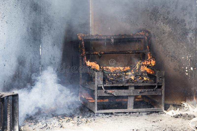 Chair and furniture in room after burned by fire in burn scene o stock image