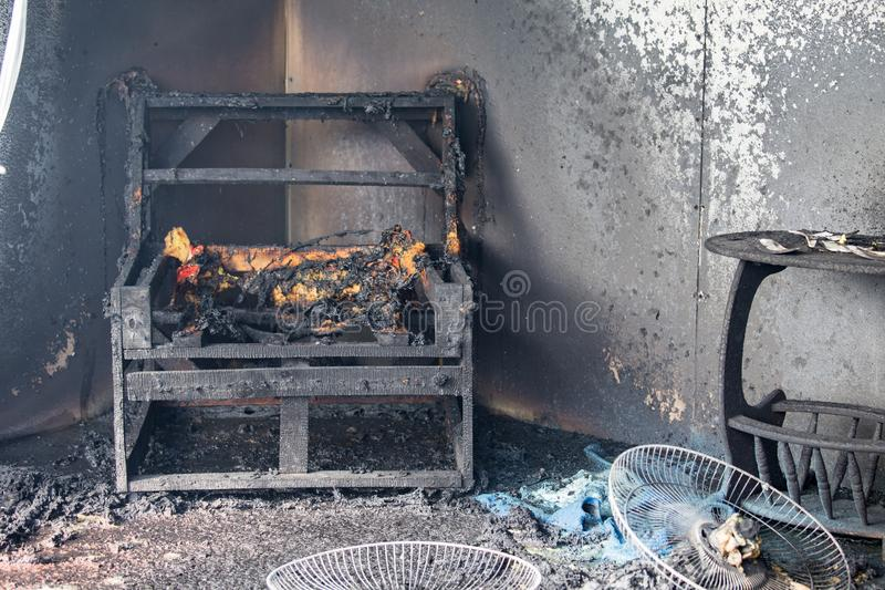 Chair and furniture in room after burned by fire in burn scene o. Chair and furniture in house after burned by fire with smoke and dust in burn scene of arson stock images