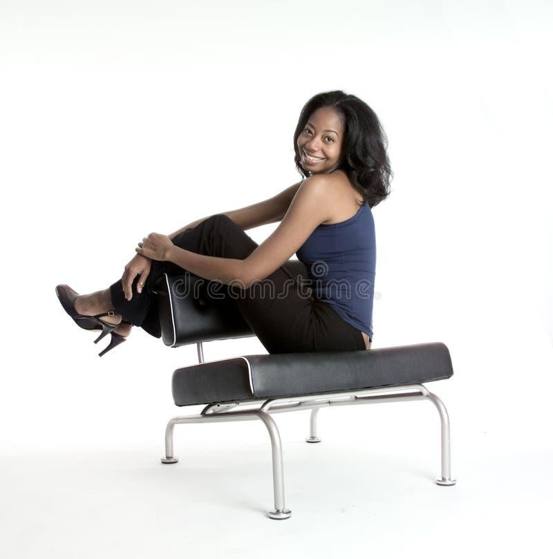 chair girl seated smiling στοκ εικόνες
