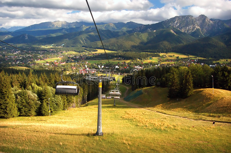 A chair-lift. In Tatra Mountains stock photography
