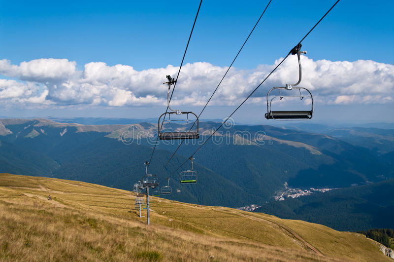 Chair lift. Two-seats chair lift in the mountains stock image