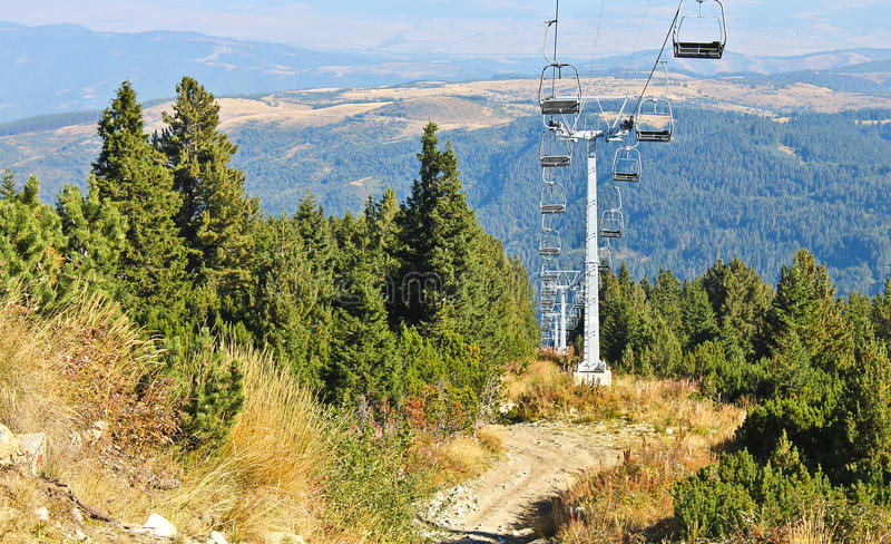 Chair lift. In the forest in autumn royalty free stock photos