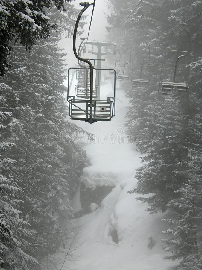 Chair lift. In fai della paganella stock photography