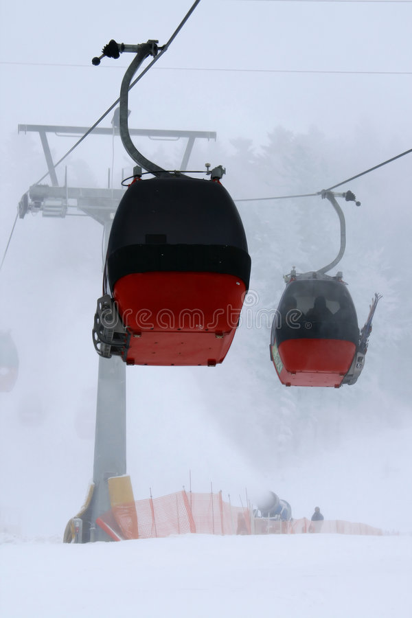Chair-lift. And ski slope; high mountain, winter ski area stock images