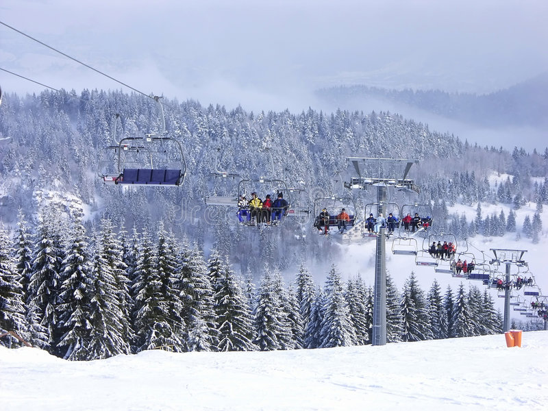 Chair lift. Skiers on chair lift stock images