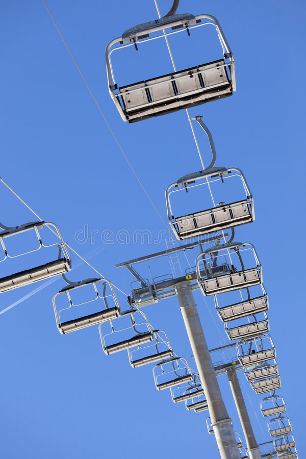 Chair lift. Low angle view of a chair lift stock photography