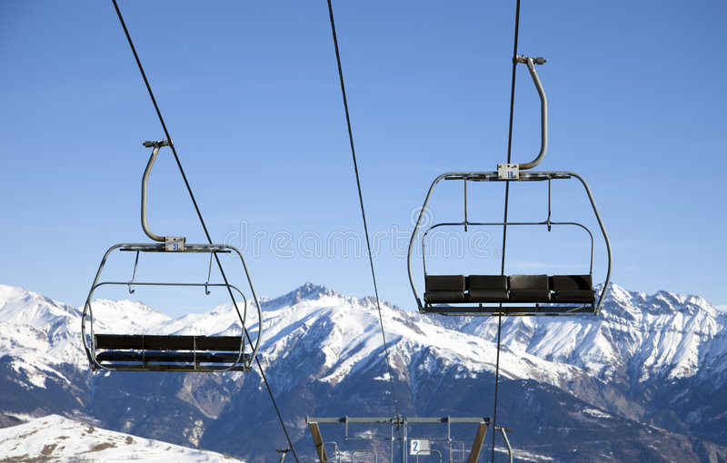 Chair lift. Front view of chair lift moving up and down royalty free stock image
