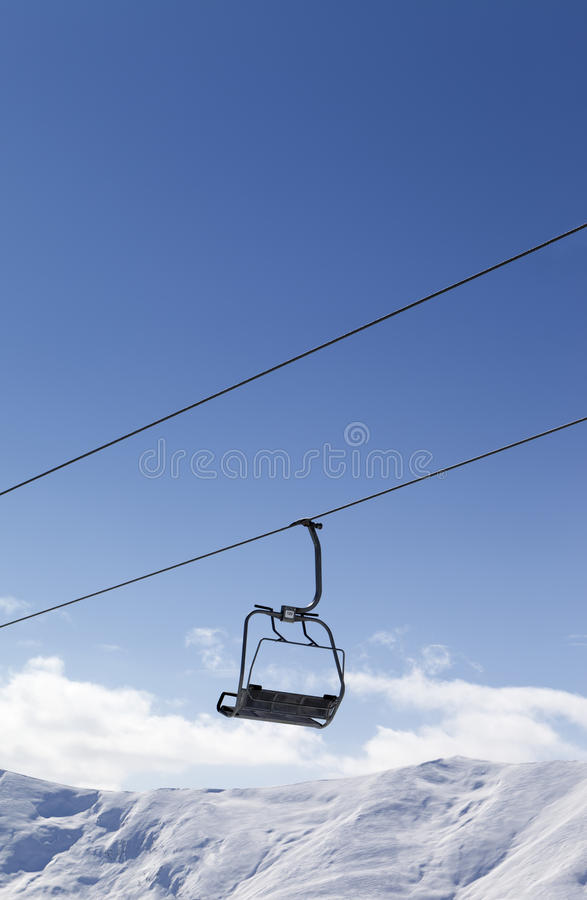 Chair lift against blue sky