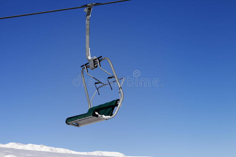 Chair-lift and blue sky. Greater Caucasus, Mount Shahdagh. Qusar rayon of Azerbaijan royalty free stock images