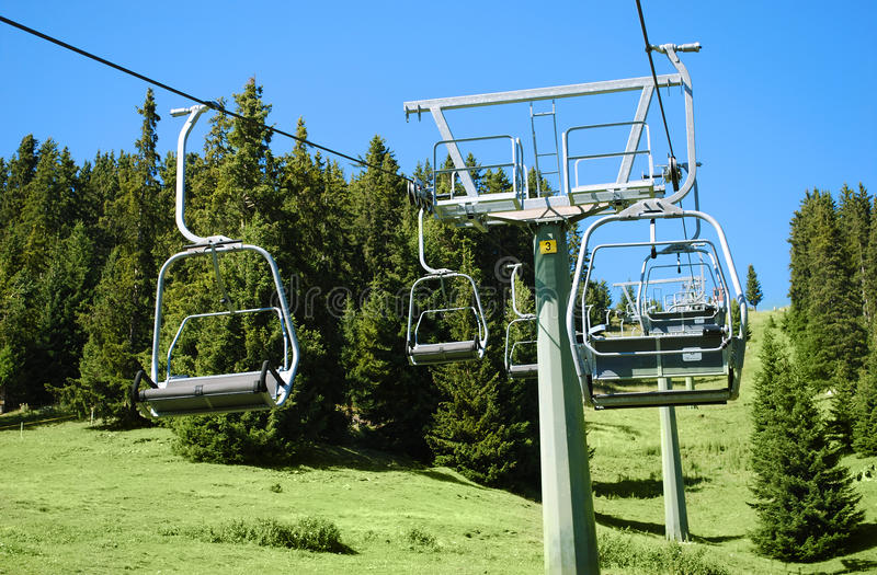Chair lift and landscape. View of chair lift during summer day royalty free stock images