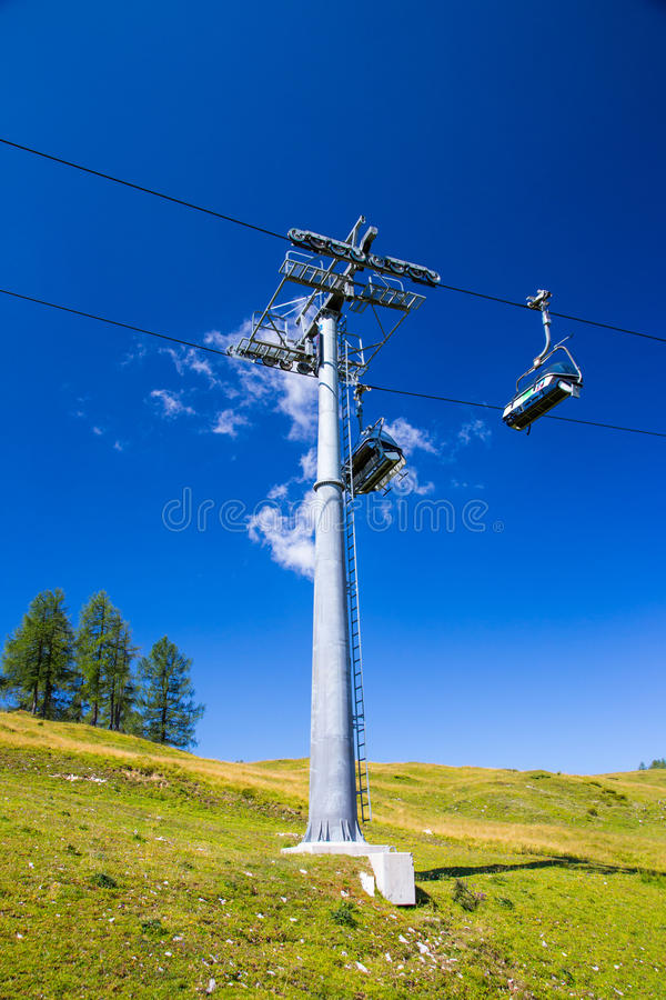 Chair lift. Modern chair lift in the high mountains Austria royalty free stock photography