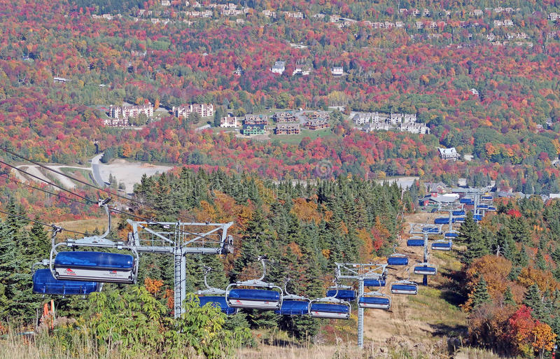 Chair lift. Mount Snow Ski Resort, West Dover Vermont summit in Fall colors and Green Mountains forest royalty free stock photo