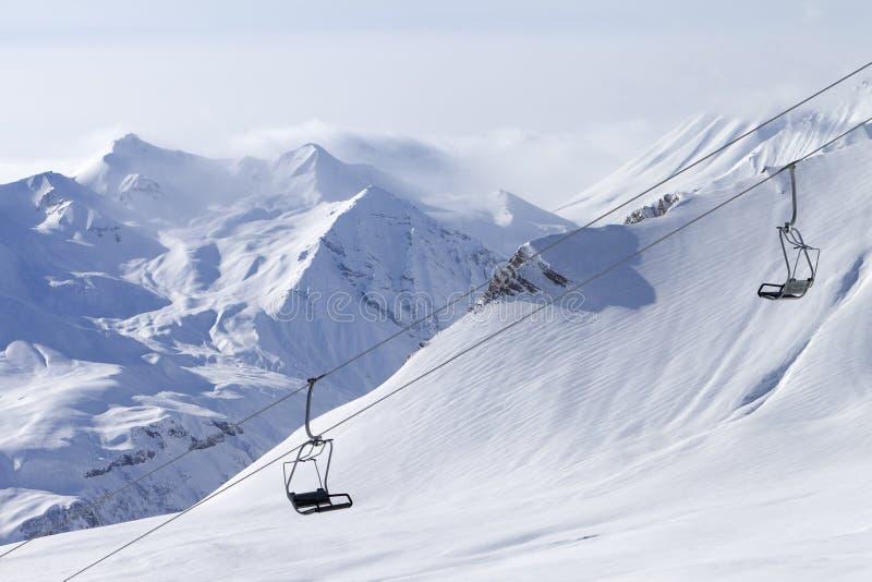 Chair lift at ski resort. Caucasus Mountains, Georgia, Gudauri stock image
