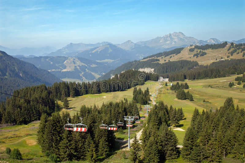 A chair lift in summer mountains. Avoriaz, France royalty free stock image