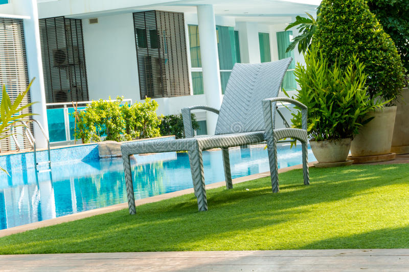 Chair near swimming pool. In home stock photo