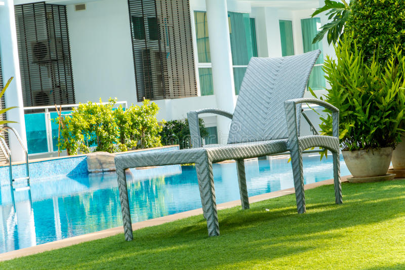 Chair near swimming pool. In home royalty free stock image