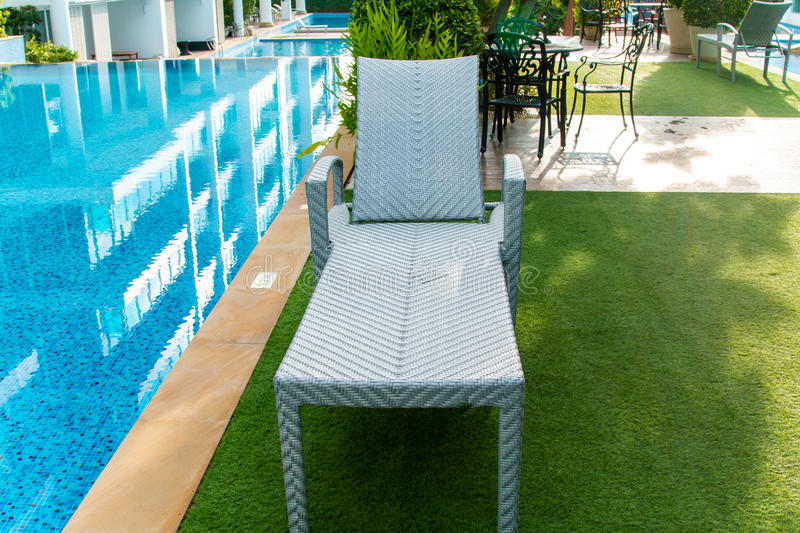 Chair near swimming pool. In home stock images