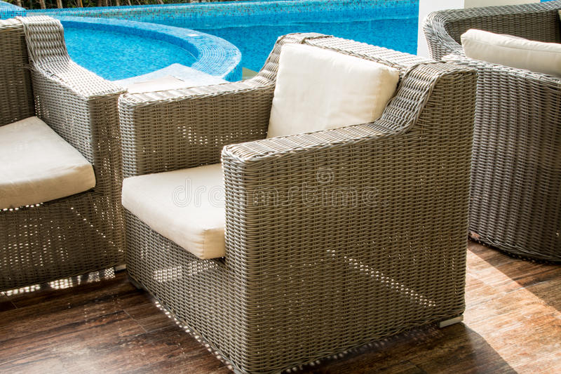 Chair near swimming pool. In home royalty free stock photos