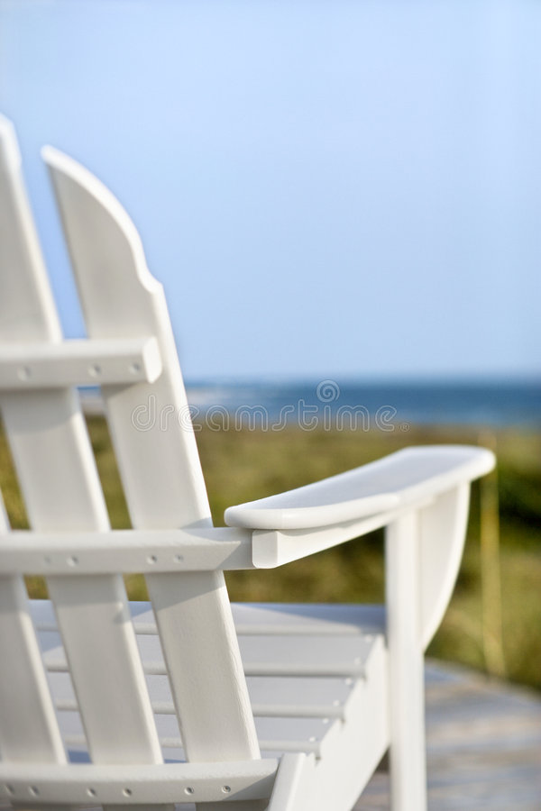 Chair overlooking ocean royalty free stock photos