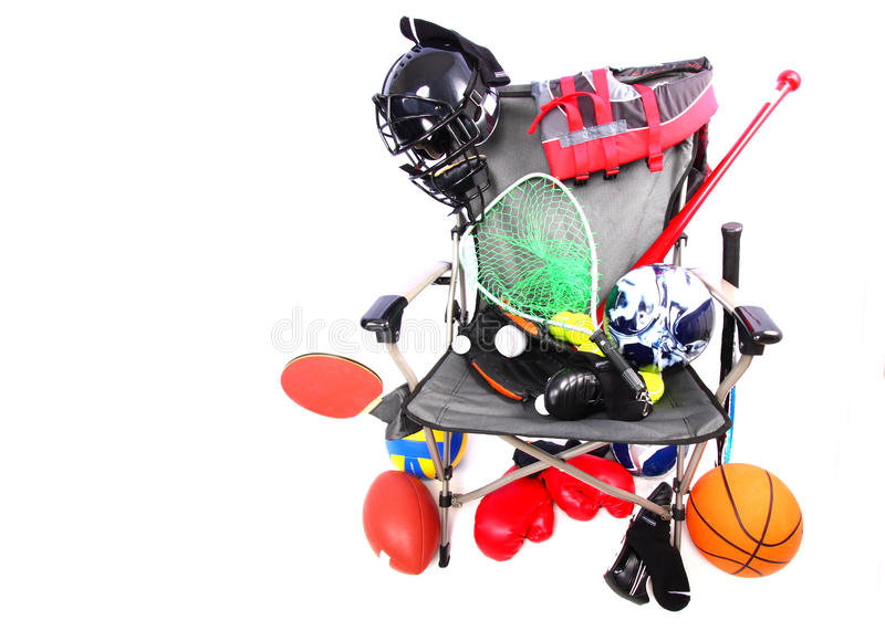 Chair packed with sports equipment royalty free stock photography