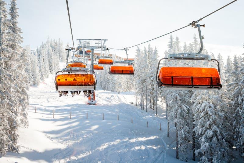 Chair ski lift. Modern ski chair-lift in Austrian ski resort stock photography
