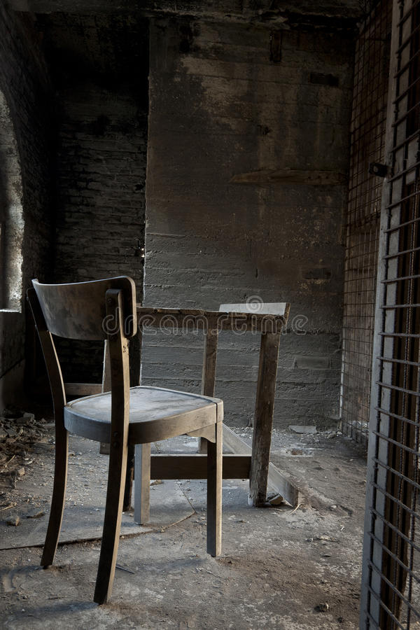 Chair and table in abandoned warehouse stock photos