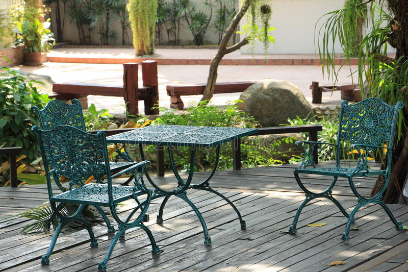 Chair and table in garden royalty free stock images