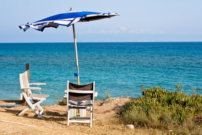 Chair and umbrella. On the beach royalty free stock images