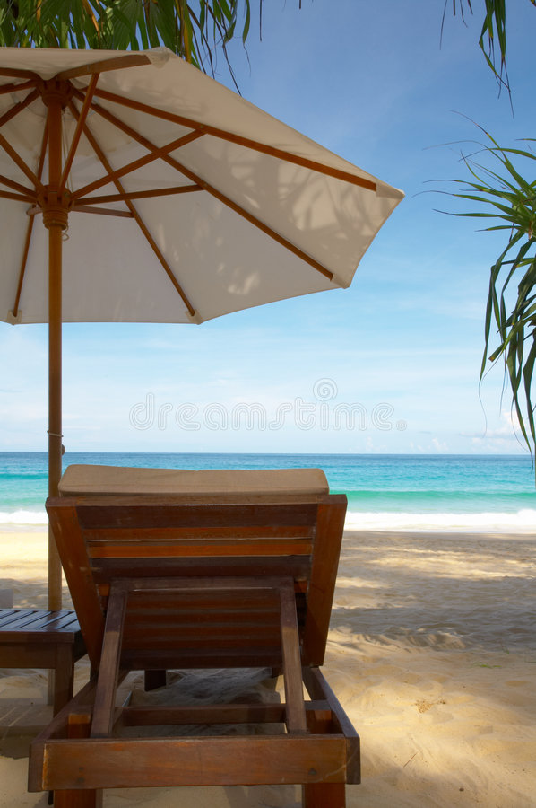 Chair and umbrella. View of nice chair and umbrella on mangrove beach royalty free stock photography