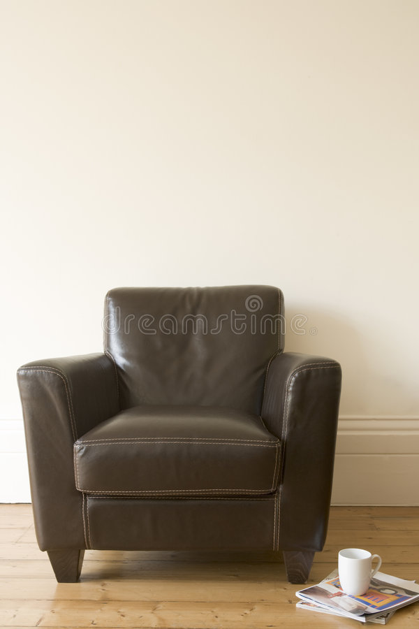 Free Chair With Coffee Mug And Magazine Beside It Stock Image - 5687711