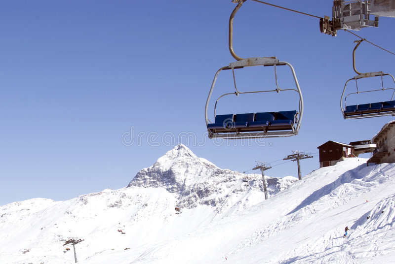 Chairlift. Empty chairlift at ski resort royalty free stock photo
