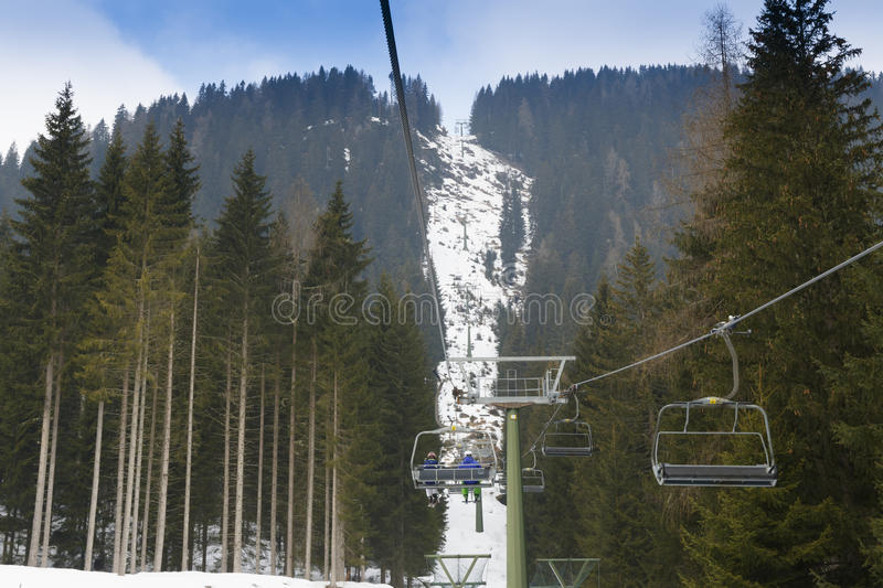 Chairlift Molino - Le Buse. Falcade, Belluno, Italy - March 21, 2015: 4-seater chairlift Molino - Le Buse now removed in the Dolomite Alps ski area San royalty free stock images