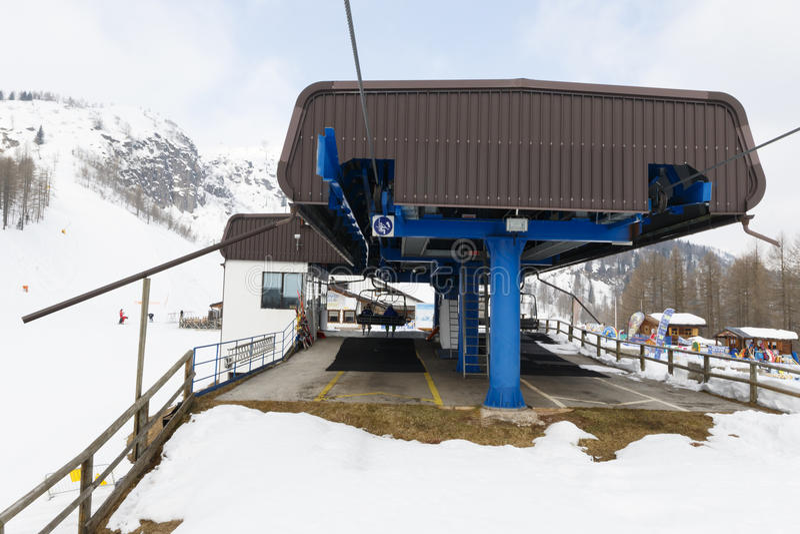 Chairlift Molino - Le Buse. Falcade, Belluno, Italy - March 21, 2015: 4-seater chairlift Molino - Le Buse now removed in the Dolomite Alps ski area San royalty free stock photos