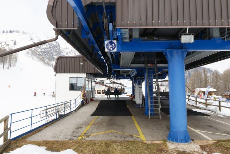 Chairlift Molino - Le Buse. Falcade, Belluno, Italy - March 21, 2015: 4-seater chairlift Molino - Le Buse now removed in the Dolomite Alps ski area San stock images