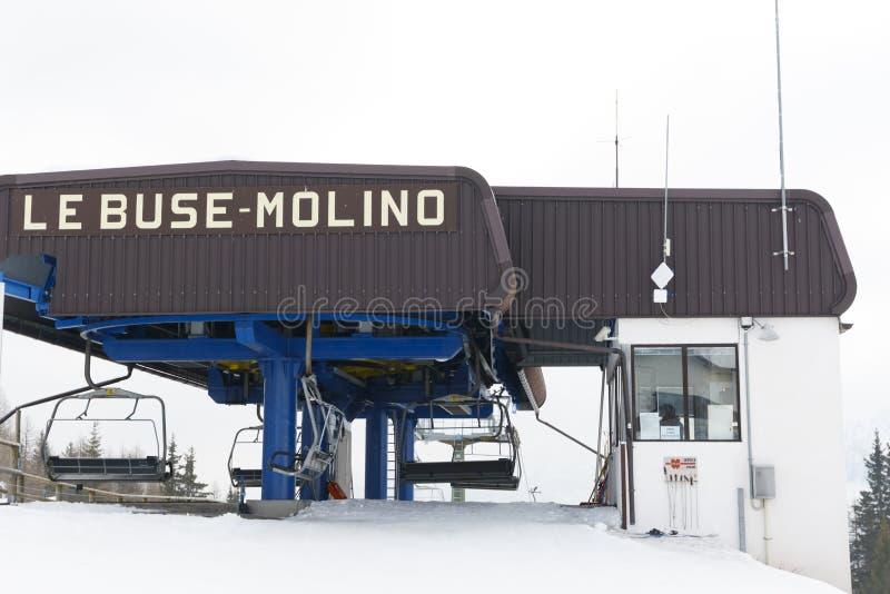 Chairlift Molino - Le Buse. Falcade, Belluno, Italy - March 21, 2015: 4-seater chairlift Molino - Le Buse now removed in the Dolomite Alps ski area San stock image