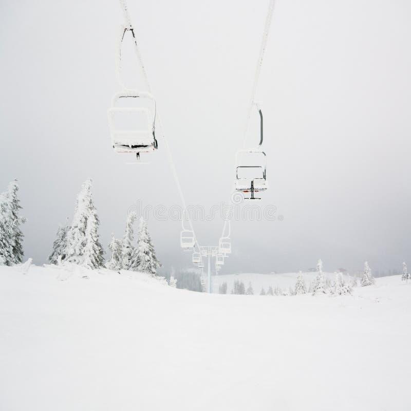 Chairlift. Ski resort. Winter landscape. Carpathian Ukraine royalty free stock photo