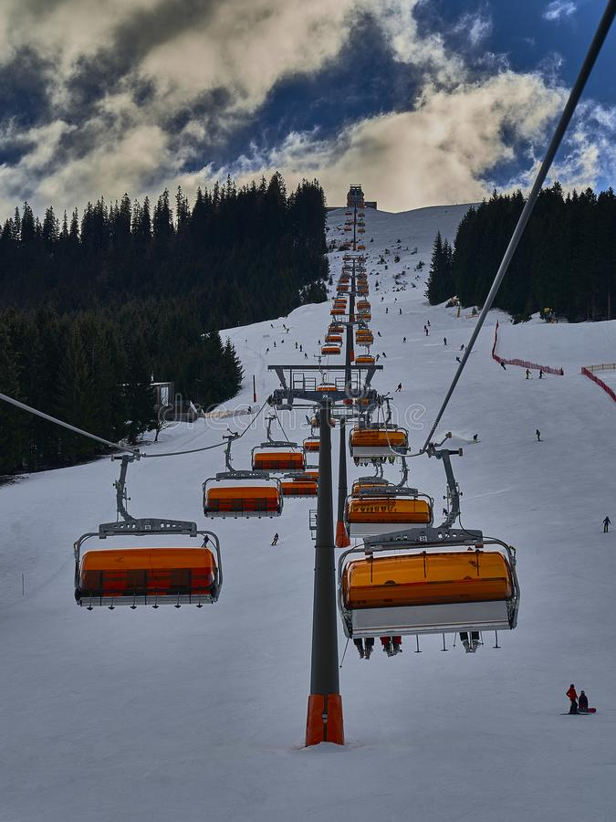 A chairlift to the top of the mountain. A chairlift to take you to the top of the mountain stock images