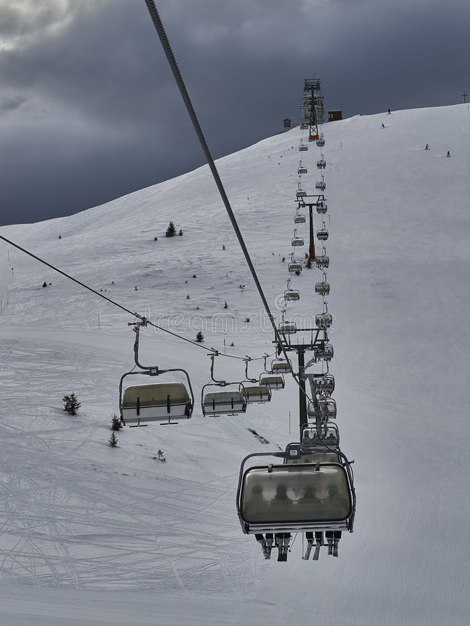 A chairlift to the top of the mountain. A chairlift to take you to the top of the mountain royalty free stock photos