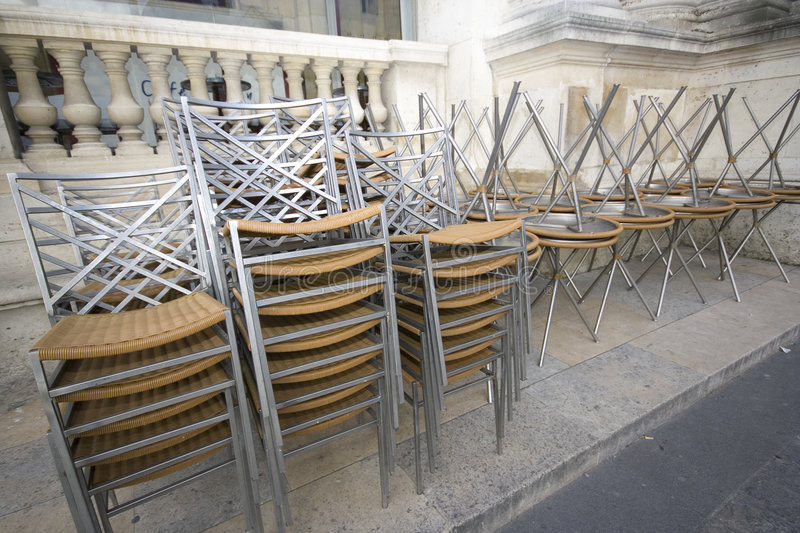 Chairs. Several chairs and tables in the place of louvre in france when the tea garden close royalty free stock photos