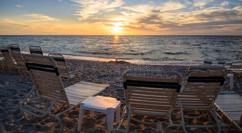 Chairs along Vanderbilt Beach in Naples, Florida. USA at sunset royalty free stock photo