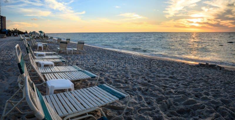 Chairs along Vanderbilt Beach in Naples, Florida. USA at sunset stock photo