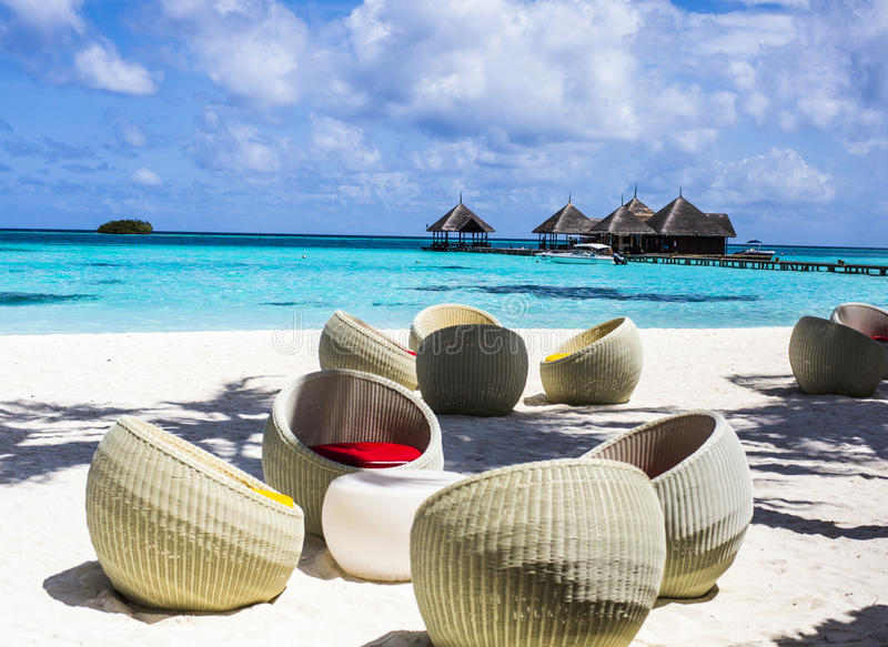 Download Chairs at a beach bar stock image. Image of blue, sand - 75985161
