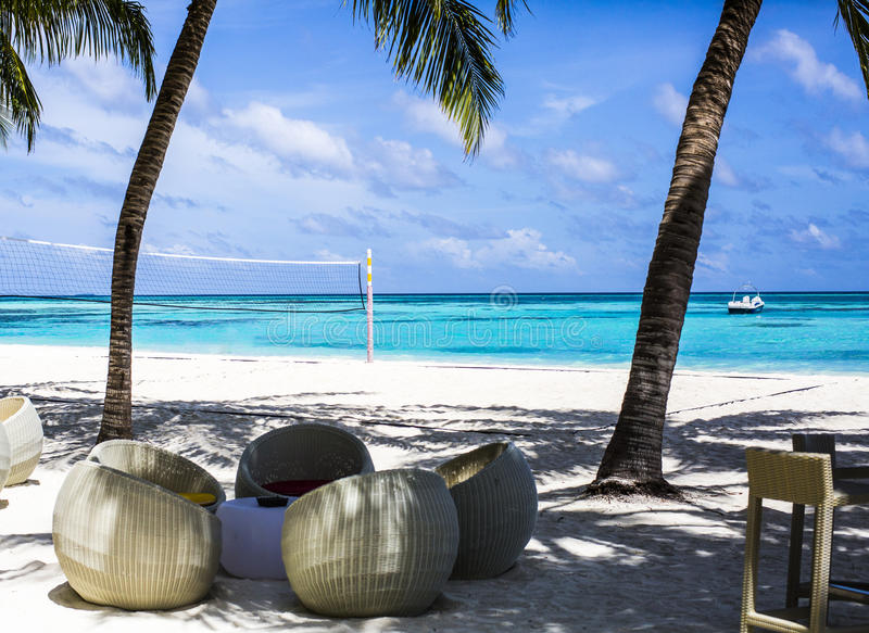 Download Chairs at a beach bar stock image. Image of water, seating - 75985237